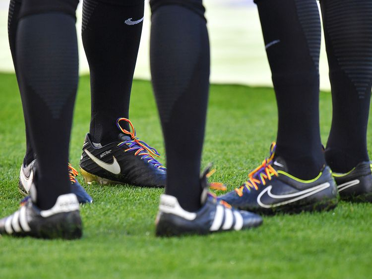 The match officials wearing rainbow laces before the Premier League match at Anfield, Liverpool in 2016