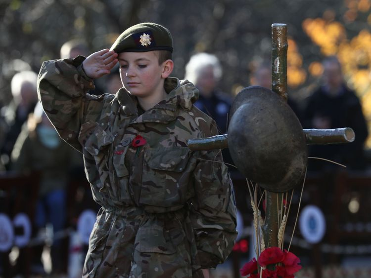 Army Cadet Force member Nathan Skinner salutes during a service in Edinburgh