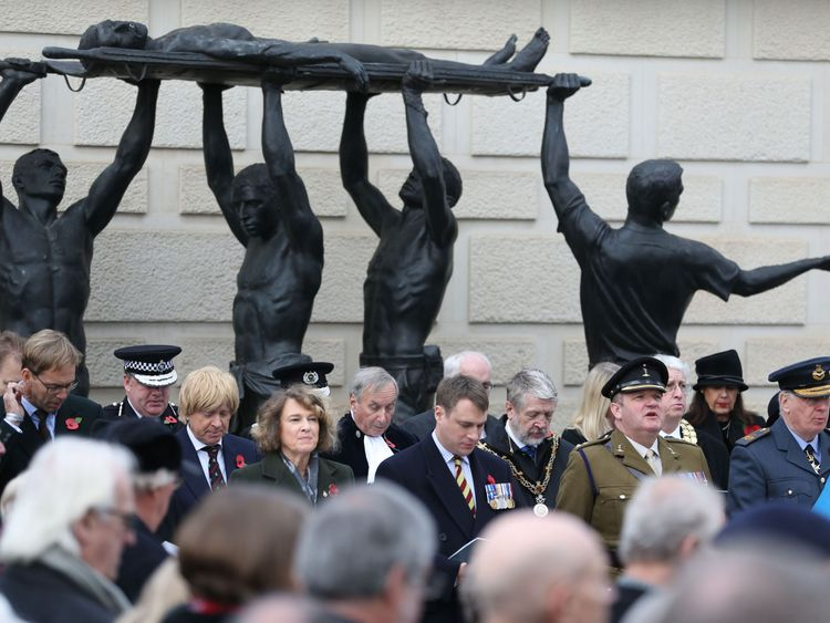 A two-minute silence is observed at the National Memorial Arboretum in Staffordshire