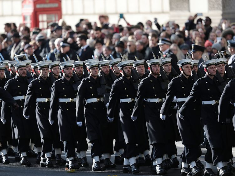 Members of the armed forces parade before the two-minute silence in Whitehall