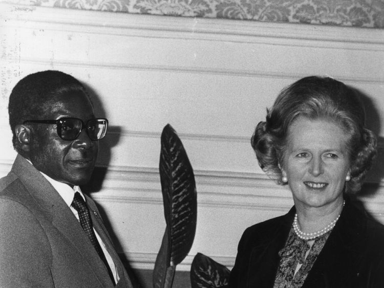 Mr Mugabe shakes hands with then prime minister Margaret Thatcher in 1980