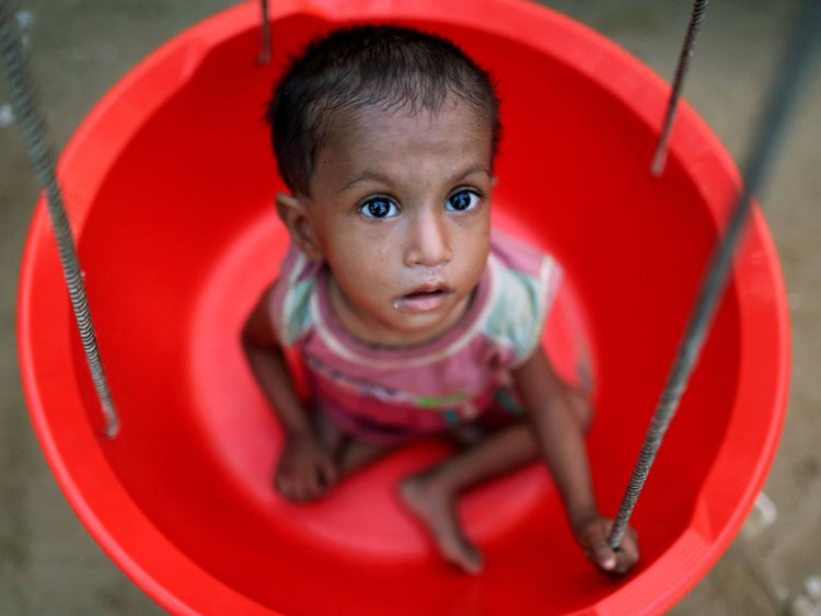 A girl is weighed at a Rohingya refugee camp