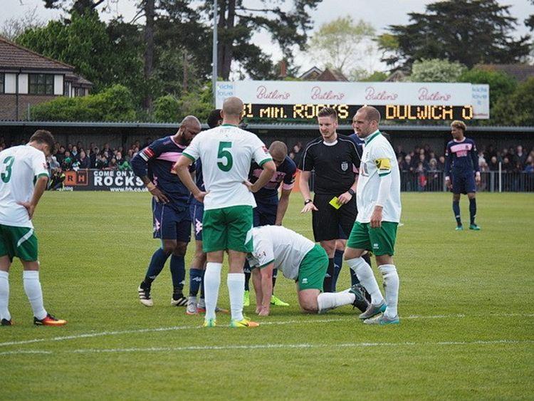 Ryan Atkin refereeing a game of football
