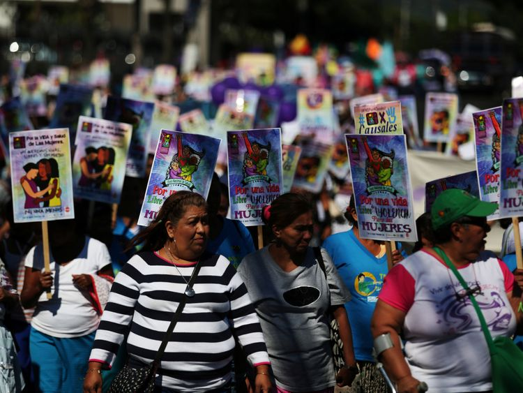 Women participate in a demonstration to commemorate the U.N. International Day for the Elimination of Violence against Women in San Salvador El Salvador
