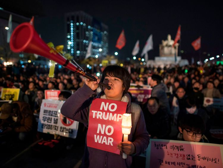 Protesters against US President Donlad Trump gather during a rally in the Gwanghwamun area of central Seoul on November 7, 2017