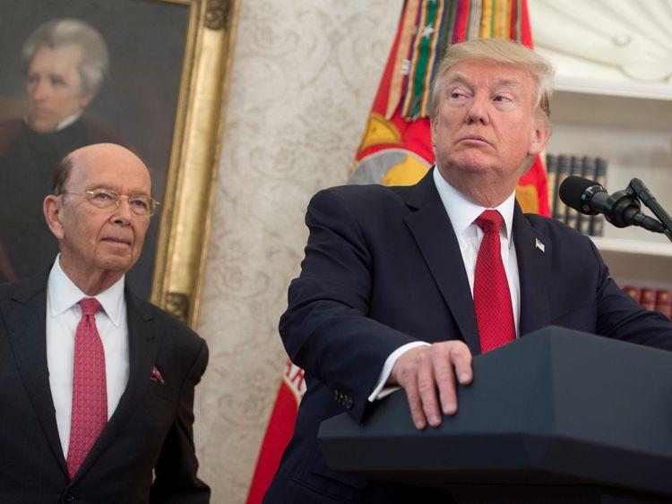 US President Donald Trump speaks alongside Secretary of Commerce Wilbur Ross