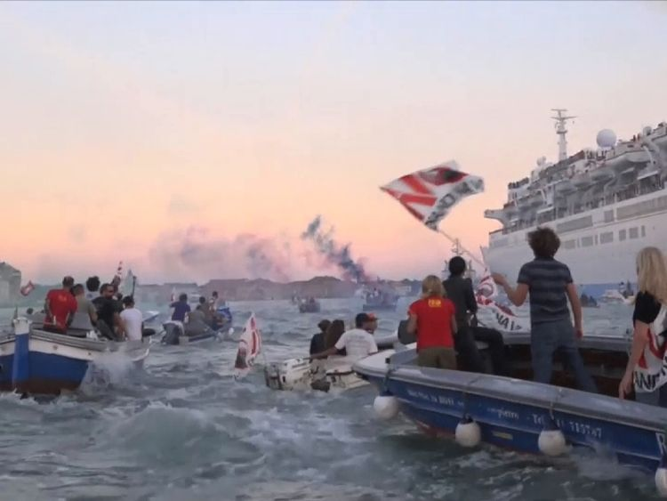 Protesters greet a cruise ship in Venice