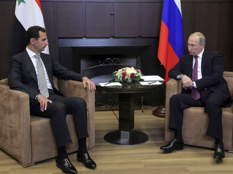 Vladimir Putin meets with Bashar al-Assad in the Black Sea resort of Sochi, Russia