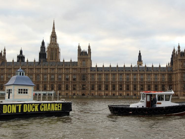 A giant duck house is towed past Westminster at the height of the expenses scandal in 2009