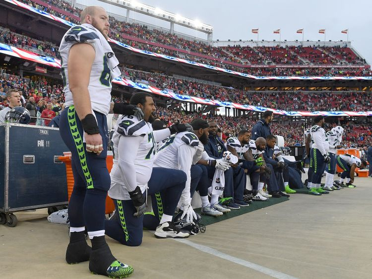 Seattle Seahawks players kneel during the national anthem on Sunday