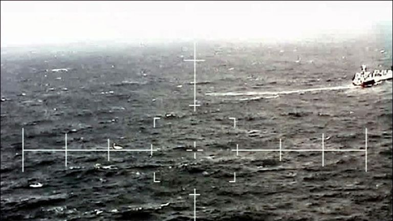 RFA Argus coming to the aid of a British yachtsman stricken in rough seas in the Bay of Biscay