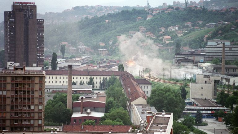 Shells hit houses in the suburbs of Sarajevo