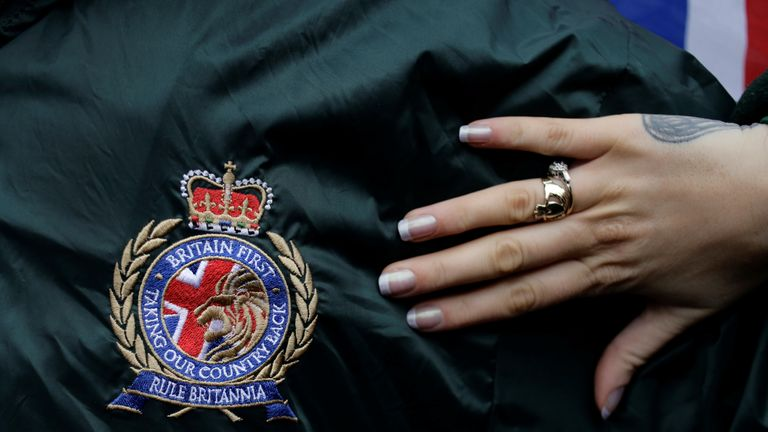A supporter wears a Britain First logo during a rally in Rochester in 2014