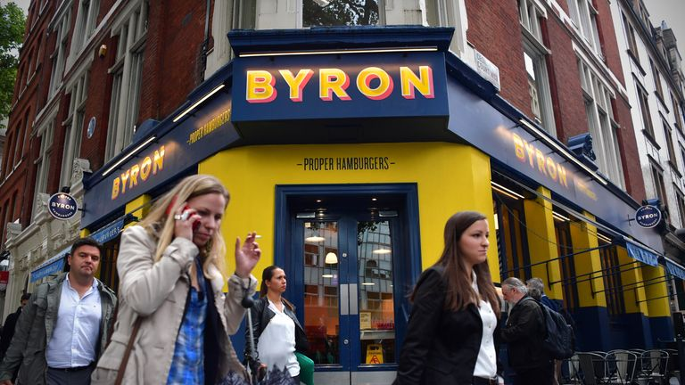 LONDON, ENGLAND - AUGUST 02: People walk past a Byron burger restaurant on August 2, 2016 in London, England. The British restaurant chain are alleged to have organised a training day for foreign staff in the capital, who were later arrested and deported by government authorities. (Photo by Carl Court/Getty Images)