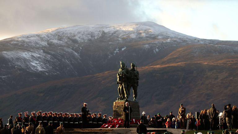 Serving servicemen and veterans attend a Remembrance Sunday Service at the Commando Memorial at Spean Bridge