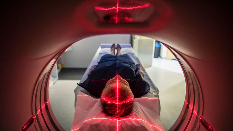 People will go into a CT scanner to see if they have signs of cancer. File pic