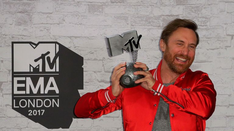 French DJ David Guetta poses with the award for best electronic act