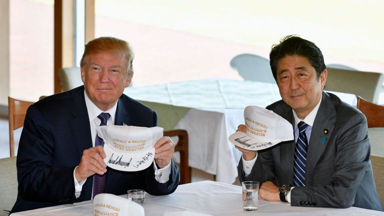 Mr Trump and Mr Abe signed Trump-style baseball caps