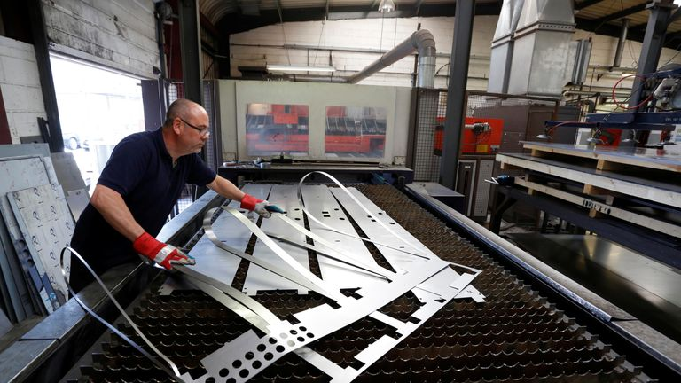 Laser operator Shaun Clements removes an offcut at Contracts Engineering Ltd, a steel products manufacturer, in Sittingbourne, southeast England, Britain May 9, 2015