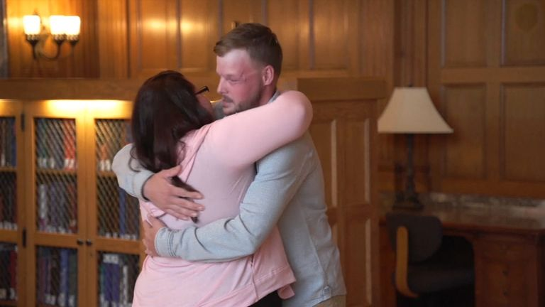 Lilly Ross hugs Andy Sandness - the man given her dead husband's face