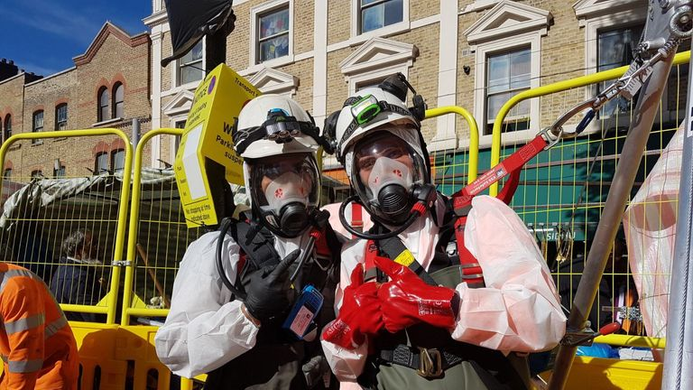 Fatberg fighters: Two workers celebrate their victory. Pic: Thames Water