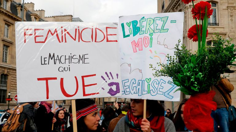 A woman holds a sign reading 'Feminicide, machismo that kills' during a demonstration against violence against women on the Place de la Republic in Paris on November 25, 2017. November 25 is the International Day for the Elimination of Violence Against Women. / AFP PHOTO / FRANCOIS GUILLOT (Photo credit should read FRANCOIS GUILLOT/AFP/Getty Images)