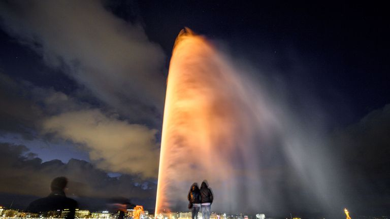 The 140m height landmark Fountain of Geneva is illuminated in orange to commemorate United Nations-backed International Day for the Elimination of Violence Against Women on November 25, 2017 in Geneva