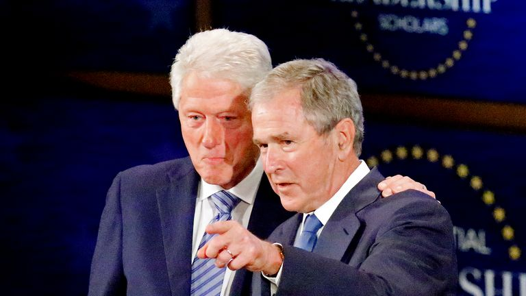 DALLAS, TX - JULY 13: Former presidents Bill Clinton (L) and  George W. Bush stand on stage together at the Presidential Leadership Scholars Graduation Ceremony at the George W. Bush Institute  on July 13, 2017 in Dallas, Texas. (Photo by Stewart  F. House/Getty Images)