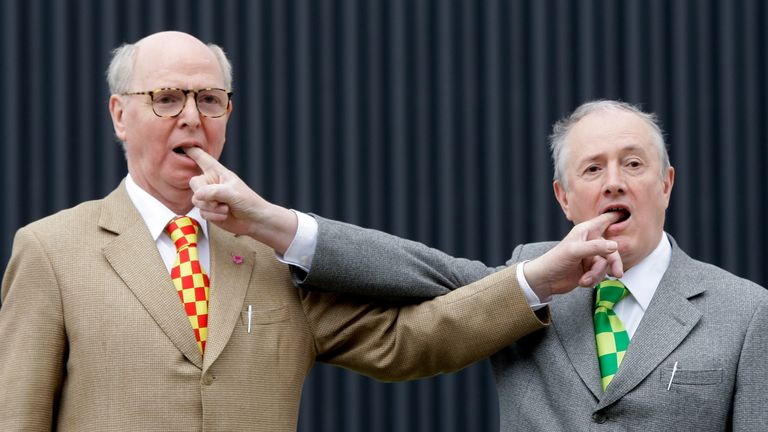 Gilbert & George pose for the cameras at the opening of a previous exhibition in Berlin