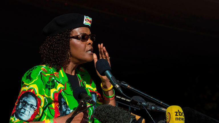 Mrs Mugabe wears a shirt bearing her husband's face at a ZANU-PF youth rally