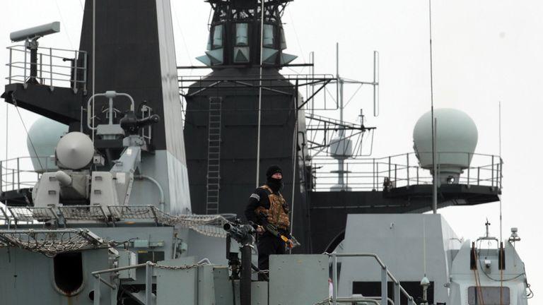 A Royal Marine stands onboard HMS Bulwark