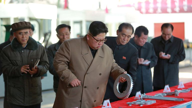 Kim Jong Un gives field guidance to the Kumsong Tractor Factory