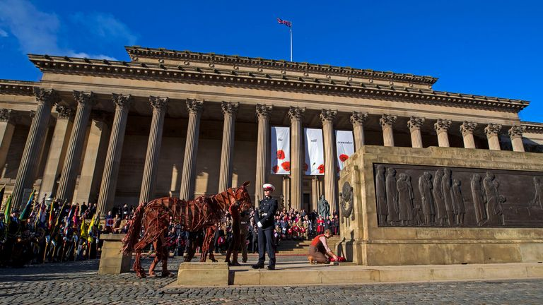 A Remembrance Sunday service at St George's Hall in Liverpool, as Michael Morpurgo's War Horse joined the parade and laid a wreath.