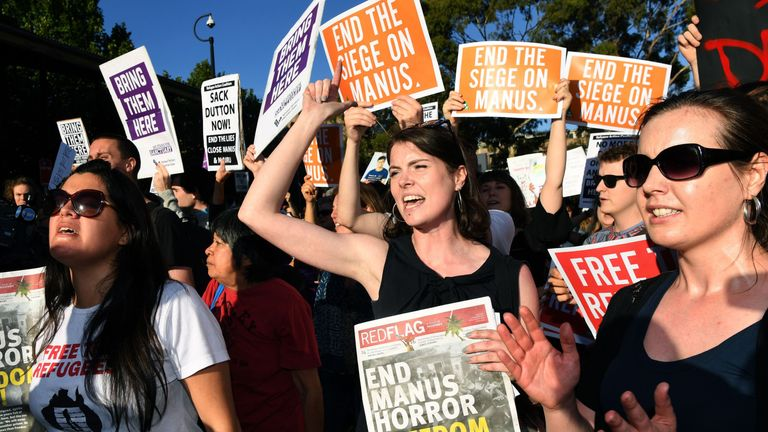 Protesters chant at a Liberal Party fundraiser in Sydney on November 10, 2017, as they call on the ruling Liberal coalition government to bring back 600 refugees from an Australian detention centre in Papua New Guinea