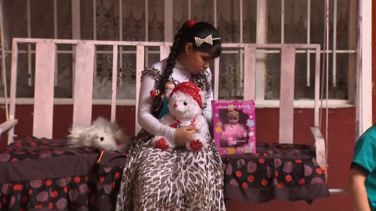 Maryam Samir with her toys at home in Mosul. She was hit in the head by an IS sniper's bullet