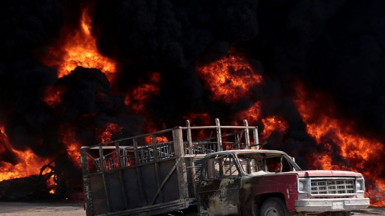 A burned out truck after an explosion caused by petrol siphoning