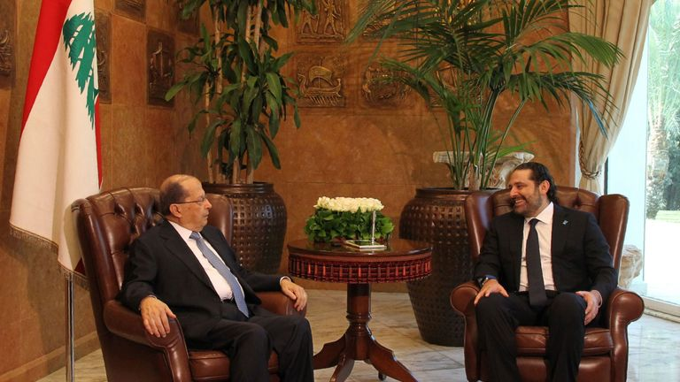 President Michel Aoun (left) meets with newly appointed Prime Minister Saad Hariri in November 2016