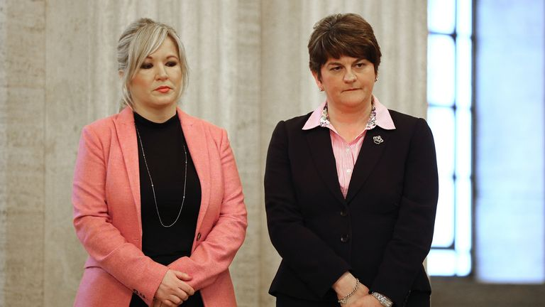 BELFAST, NORTHERN IRELAND - MARCH 22: Sinn Fein leader Michelle O'Neill (L) and (DUP) Democratic Union Party Leader Arlene Foster wait to sign a book of condolence at Stormont on March 22, 2017 in Belfast, Northern Ireland. Northern Ireland's Former Deputy First Minister Martin McGuinness died overnight on Monday 20th March 2017.