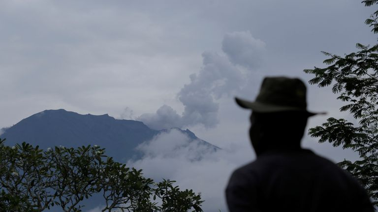 A villager looks at Mount Agung following a phreatic eruption in Rendang Village, Karangasem, Bali