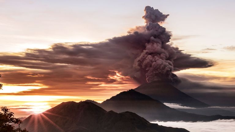 Mount Agung volcano spews smoke and ash in Bali, Indonesia
