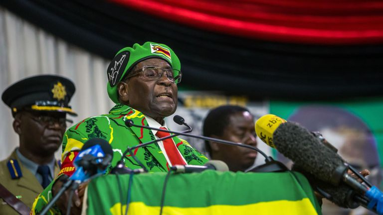 imbabwe's President Robert Mugabe delivers a speech during a meeting of his party's youth league where he hinted at a cabinet reshuffle, on October 7, 2017, in Harare