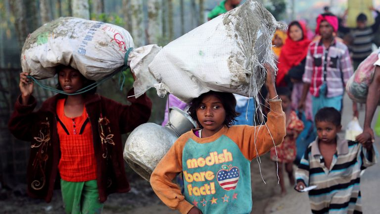 A little girl makes her way towards a makeshift camp in Cox's Bazar, Bangladesh