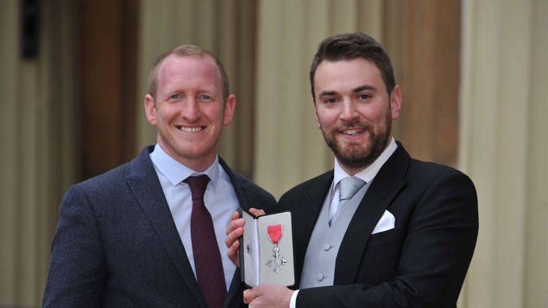 Jonny Benjamin, with Neil Laybourn (left), after receiving his MBE