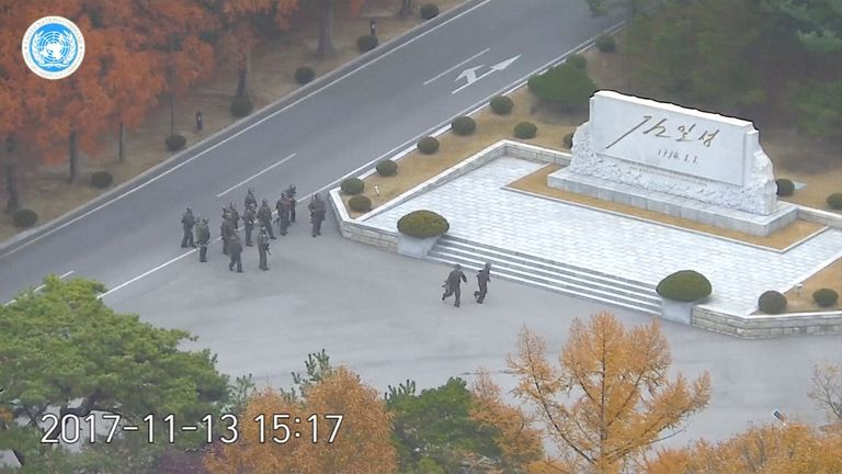 North Korean soldiers hold rifles and gather in the North Korean side of the Joint Security Area at the Demilitarized Zone