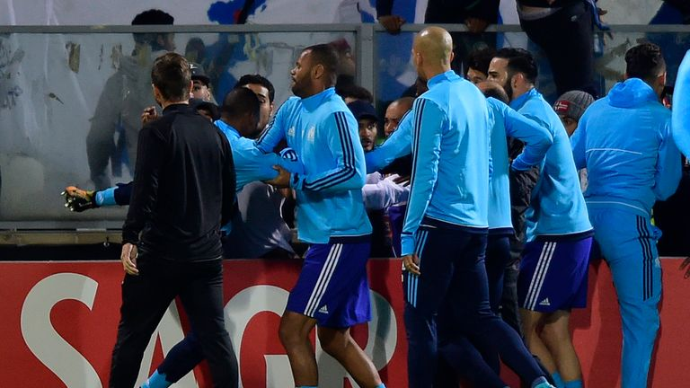 Patrice Evra appears to aim a kick at a fan before the start of a Europa League match in Portugal