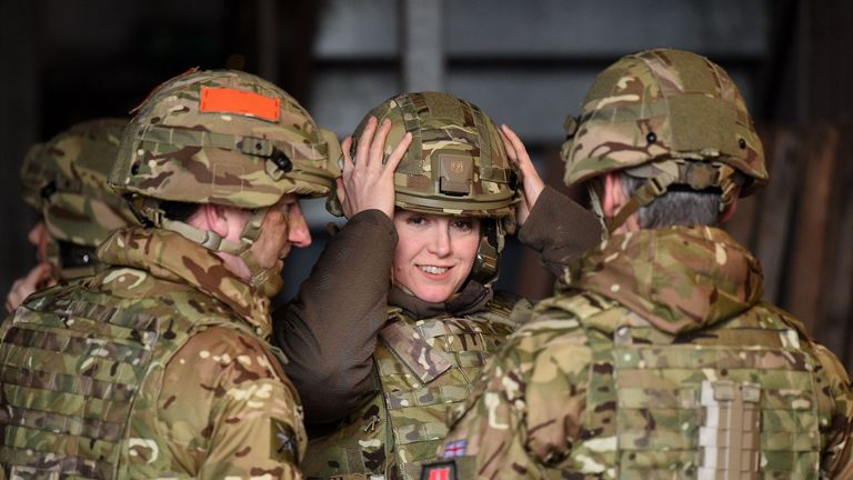 Armed forces minister Penny Mordaunt (centre) adjusts her helmet prior to watching a live firing exercise by members of the Infantry Battle School at the Sennybridge Training Area in the Brecon Beacons, Wales PRESS ASSOCIATION Photo. Picture date: Thursday January 28, 2016. See PA story MILITARY . Photo credit should read: Andrew Matthews/PA Wire