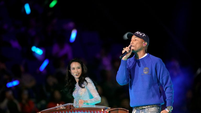 Pharrell Williams performs with Hong Kong singer Karen Mok