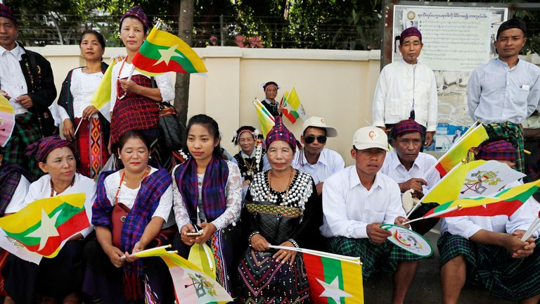 People gather outside the the residence of Cardinal Charles Maung Bo, Archbishop of Yangon,