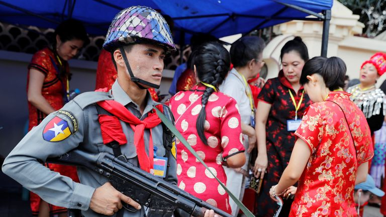 Police stand guard outside the residence of Cardinal Charles Maung Bo, Archbishop of Yangon
