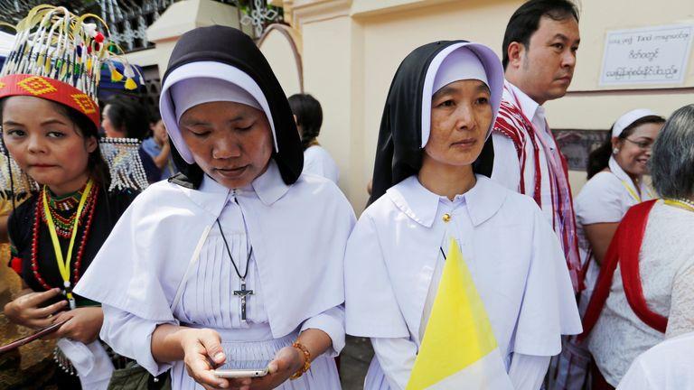 Nuns wait outside the residence of Cardinal Charles Maung Bo, Archbishop of Yangon